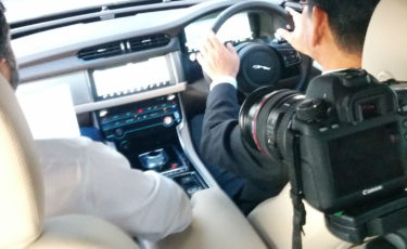 Filming a car dashboard in Japan for a case study video.